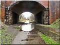 SJ9594 : Puddle under Dowson Road by Gerald England