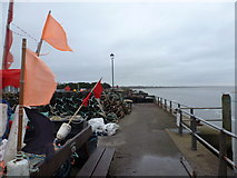 SZ1891 : Mudeford: flags aflutter on the quayside by Chris Downer