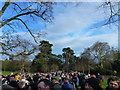 TF6928 : Crowd along Church Walk Sandringham - Christmas Day 2011 by Richard Humphrey