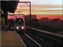 SJ8297 : Evening Tram at Cornbrook by David Dixon