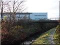 SJ8293 : Buildings at Chorlton High School, and Chorlton Brook by Phil Champion