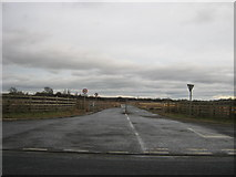 NZ2711 : Entrance from Croft Road to sewage treatment works by peter robinson