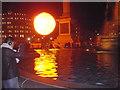 TQ3080 : Giant 'sun' rising over Trafalgar Square by PAUL FARMER