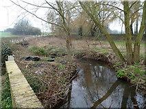 ST5192 : Dumped tyres alongside Mounton Brook, Pwllmeyric by Jaggery