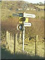 TR1844 : Close up of signpost at road junction by John Baker