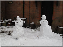 TQ4077 : Snowmen go to church by Stephen Craven