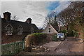 TQ2551 : Cottages on Pilgrims' Way bridleway by Ian Capper