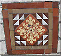 SE6051 : Decorative tile on the former drill hall wall by Pauline E