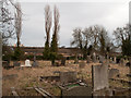 NZ2557 : Graves in the churchyard of St. Andrew, Lamesley by Trevor Littlewood