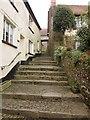 SS6308 : Steps to churchyard, Winkleigh by Derek Harper