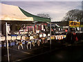 SJ7560 : Sandbach market  - clothing by Stephen Craven