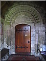 SY2591 : Norman doorway in St Michael's Church Axmouth by Rod Allday