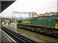 TQ2182 : Freight train passing Willesden Junction by Christopher Hilton