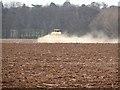 NT6278 : Fertiliser spreading at Kirklandhill Farm by Oliver Dixon
