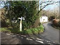 SX0875 : Road junction and unusual signpost at Wenford Bridge by David Smith