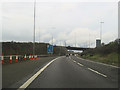 SU6404 : M27 west approaching M275 overbridge at junction 12 by John Firth