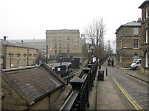 SE1338 : Saltaire: station and Salt's Mill by John Sutton