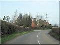 SO5969 : B4214 approaching Rugpits by John Firth