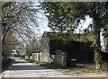 TL4349 : Newton: Town Street in March by John Sutton