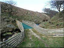 SD9921 : Footbridge over Turvin Clough in Trimming Dale by Humphrey Bolton