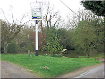 SU7089 : Pond and village sign at Russell's Water by Stuart Logan