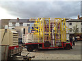 SP2864 : Fairground ride waiting to be put up, Market Place by Robin Stott