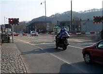 SH5639 : Barriers down, High Street level crossing, Porthmadog by Jaggery
