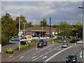 SX9490 : Shell garage, Countess Wear Roundabout by Anthony Vosper
