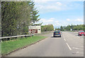 NY5324 : A6 crossing M6 north of Hackthorpe by John Firth