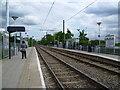TQ3165 : Waddon Marsh Tramlink Stop by Marathon