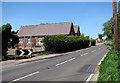 TM2994 : Norwich Road past Woodton school by Evelyn Simak