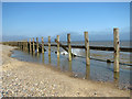 TG2938 : Remains of wooden revetments at Trimingham beach by Evelyn Simak
