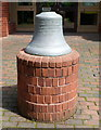 TQ2484 : Church bell on a plinth outside St Cuthbert's Church West Hampstead by Jaggery