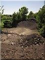 ST0411 : Gravel heaps on the former A38 by Derek Harper