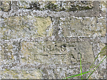TA0183 : Inscription on the loop-holed wall in Seamer by John S Turner