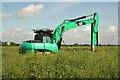 SK8869 : Digger at Swinethorpe by Richard Croft
