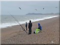 TG0844 : Sea anglers on Salthouse Beach by Oliver Dixon