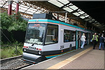 SJ8499 : Manchester Victoria:  Tram 2004 southbound for Piccadilly by Dr Neil Clifton
