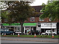 TQ2064 : Shops, Kingston Road by Colin Smith
