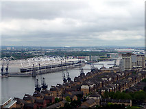 TQ3979 : Houses and Cranes from Cable Car across The Thames by Christine Matthews