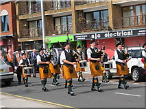 J3731 : The Crimson Arrow Pipe Band of Newcastle parading along Main Street by Eric Jones