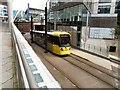 SJ8497 : An Altrincham bound tram by Gerald England