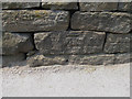 SE1408 : Cut benchmark on New Mill Road by John Slater