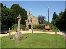 SU1012 : War memorial and St James' church, Alderholt by David Gearing