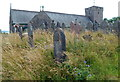 SN9408 : Overgrown part of the churchyard,  St Cynog's Church, Penderyn by Jaggery