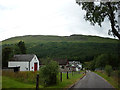 NN2939 : Looking down the street, Bridge of Orchy by Karl and Ali