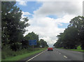 NY5528 : A66 approaching Whinfell Park by John Firth