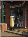 SD5216 : Gold pillar box, the Carrington Centre by Ian Taylor