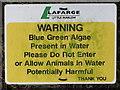 SU8887 : Blue green algae warning sign, Spade Oak lake by David Hawgood