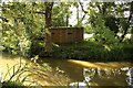 TQ5545 : Pillbox by the River Medway by Richard Croft
